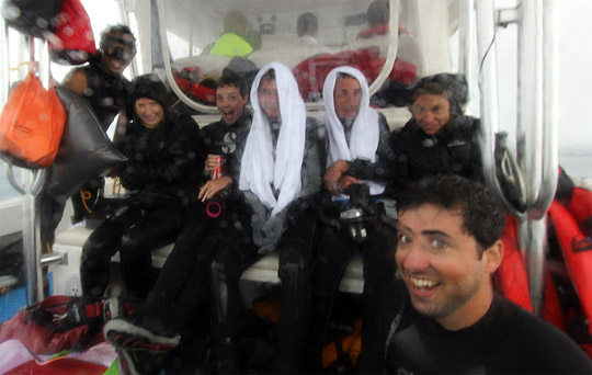 Scientific team huddle on the dive boat